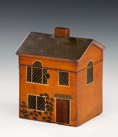 A single compartment Georgian painted tea caddy in the form of a country house. Circa 1810