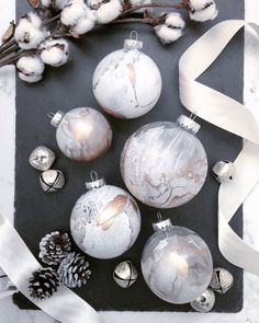 Nothing says Tis the Season like these elegant water-dipped glass ornaments to decorate your home during the holidays! Hand-dipped individually for a unique, one-of-a-kind marbleized effect. We can also personalize each ornament with a name written in black or gold. These ornaments will have some clear spots to allow the light to shine through them and enhance the marble details. Ornaments are made of glass. Base marble color is a white marble and custom colors are always welcome as an add…