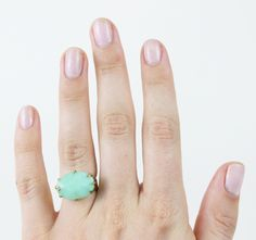 "Chrysoprase is gemstone variety of chalcedony. The name is derived from the Greek ""chrysos,"" meaning gold and green. Enter a wicked ""green-with-envy"" line here. #mooreaseal"