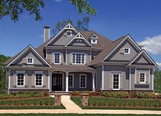 Master-Down Classic House Plan - 15619GE | 1st Floor Master Suite, Butler Walk-in Pantry, CAD Available, Corner Lot, Den-Office-Library-Study, Jack & Jill Bath, MBR Sitting Area, PDF, Photo Gallery, Sloping Lot, Traditional | Architectural Designs