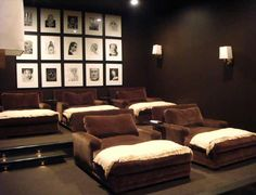 Media Room / Man Cave with black walls and chocolate brown chaises. Interior Design: Melanie Turner