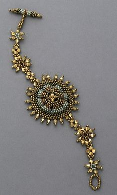 Gather one edge of a peyote stitch band to make a ruffled medallion a the center of a star-studded bracelet.