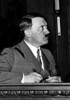 Hitler sitting next to a thermometer in 1933. Look at his eagle-eyed expression.