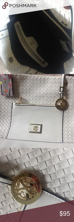 Woven white with Gold! This bag is a stunner.  Very durable white woven.  Gorgeous heavy gold detail.  Black and white polka dot interior.  Zip pockets and open pockets. Truly a beauty.   Comes with oversized dust bag with CL logo Christian Lacroix Bags Totes