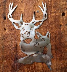 A personal favorite from my Etsy shop https://www.etsy.com/listing/221917418/hand-cut-deer-and-doe-mounted-on-barn