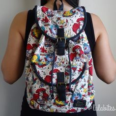 """The Little Mermaid Backpack New Ariel tattoo design backpack by Loungefly X Disney.  Materials comes in Canvas/Cotton Twill and cotton lining. Magnetic snap and Drawstring closure.   17"""" shoulder drop 14"""" high 10.75"""" wide Pockets: 1 interior zip, 1 exterior.  No Trades  No Holds. Will not respond to offer on comment section please use offer button.  thank you. Disney Bags Backpacks"""