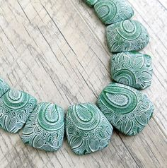 Unusual necklace First snow This necklace looks heavy but its not. Its very easy and convenient on the neck. Be sure this beautiful bohemian style necklace will complement any outfit. It can be perfect choice for your everyday wear! Necklace made of polymer clay and cotton cords.