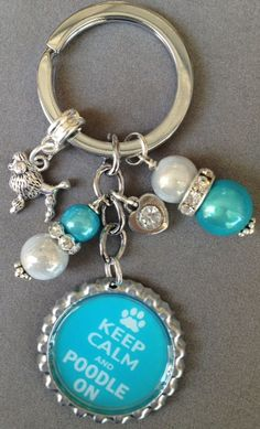 KEEP CALM and POODLE ON.  This is the perfect key chain for a poodle lover!!! This one was specially made for Katie to show her love for Cody!!  Also available with Shih Tzu, Yorkie, Chihuahua and Bichon  Just send me a message with your order saying which one you would like to receive. If ...