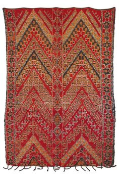 Pure Moroccan style! If you are looking for a Moroccan rug this one will amplify the cozy factor of your home! Great Moroccan tribal patterns will give your place the look of a modern nomad! Rich, warm Moroccan color. Feels great underfoot and very kid and pet friendly.All hand-knotted & wool. Vintage. Available at Maryam Montague's online Souk!