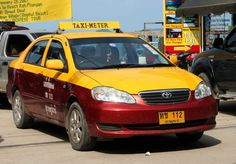 Taxis in Koh Samui are distinctive red and yellow. You can hail a taxi in the street. Confirm and agree your price your journey will be a chatty one. The drivers love to chat with the tourists and love to learn new words in another language. http://www.welovekohsamui.com/koh-samui-tourist-information/getting-around-koh-samui/