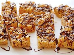 Both kids and adults will love this nutty take on crispy rice treats. Let the little chefs get creative by drizzling melted chocolate on top in unique designs.