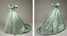 1856 Prom dress made of bright green taffeta.  Have puff sleeves and a long…