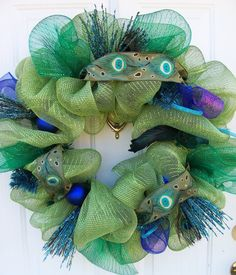 photos of geo mesh wreathes | Peacock mesh wreath by CustomCreated on Etsy