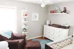 Love the colours of this nursery - white, brown, blue, red, grey.