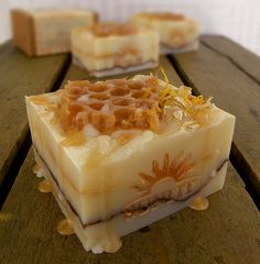 Grande Honey Creme handcrafted artisan soap is a clean cut block of scented cold process soap made from my exclusive Sunlit recipe. Each soap is carefully wrapped and nestled in its own box. What an amazing gift it will make... Gilded Layers of Honey and Creme topped with a golden soap