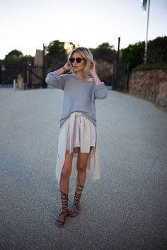 lisarvd.com | Lisa Hahnbueck is wearing a layering look by Comma with a cashmere knit, a nude cardigan on her waist and nude silk dress. Clubround Sunglasses by Ray Ban and Valentino Gladiator Sandals