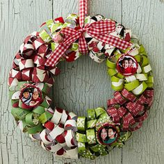 Christmas wreath with scrapbook paper strip curls - photos are hung to look like Christmas ornaments