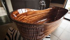 Award-winning Seattle design studio NK Woodworking crafts one-of-a-kind bathtubs from domestic and exotic hardwoods, finished with a durable marine varnish