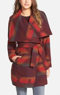 A geometric pattern in rich, warm colors give this blanket-woven coat by Steve Madden a trendy design for fall. Pair with a hobo bag and denim to finish off a stylish western look!