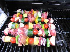 Shish Kabobs. Steak or chicken marinated, tomatoes, red potatoes, zucchini, mushroom.