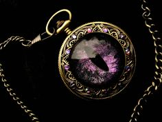 Sovereign Deluxe Pocket Watch - Color Shift Purple by LadyPirotessa dragon eye universe equipment gear magic item | Create your own roleplaying game material w/ RPG Bard: www.rpgbard.com | Writing inspiration for Dungeons and Dragons DND D&D Pathfinder PFRPG Warhammer 40k Star Wars Shadowrun Call of Cthulhu Lord of the Rings LoTR + d20 fantasy science fiction scifi horror design | Not Trusty Sword art: click artwork for source