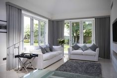 Large glazed areas such as bifold doors can be a challenge when considering privacy. We can offer several solutions for window treatments for bifold doors, including curtains, blinds, voiles and more. Curtains For Bifold Doors, Patio Door Curtains, Sliding Patio Doors, Curtains Living, Curtains With Blinds, Wave Curtains, Pleated Curtains, Long Curtains, Grey Curtains