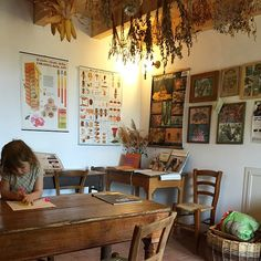 vintage table, posters, drying herbs, ...