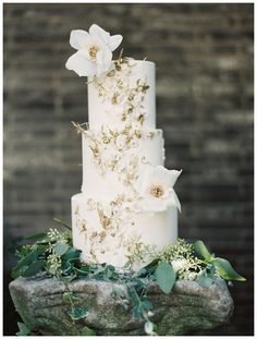White wedding cake with gold details by Maggie Austin, image by Laura Gordon.