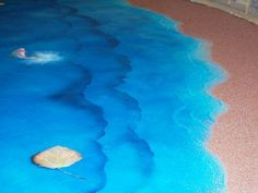 Ocean waves and sand effect in stained concrete floor