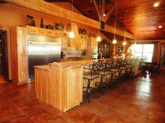 Lodge style kitchen...LOVE IT.  Although a teensy big for a cabin in the mountains