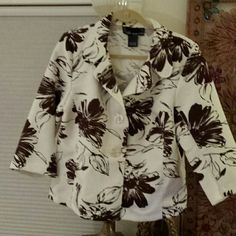 Floral jacket by susan graver This is a really sweet jacket by susan graver with the large print brown flower on a white background as a quilted style material to it but its not quilted three quarter length sleeves button-front really nice jacket Susan Graver Jackets & Coats Blazers