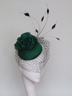 A hand blocked emerald green silk pillbox fascinator. A beautiful silk rose, shaped feathers and black veiling. 14 cms diameter fine for Royal Ascot. Secured by hat elastic which is easily hidden. This fascinator can be made in black, red, navy. Ascot Outfits, Derby Outfits, Outfits With Hats, Green Fascinator, Royal Ascot Hats, Millinery Hats, Sinamay Hats, Green Hats, Fancy Hats