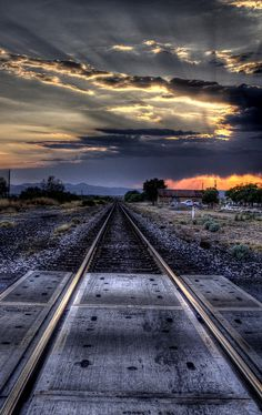 West Texas railroad tracks at sunset  have been to Texas and the road stretches through a lot of nothing on the horizon.