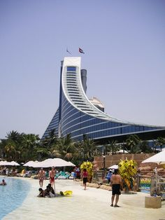 Jumeirah Beach Hotel - Dubai UAE.  WS Atkins, Architect.  Hotel guests are afforded unlimited access to the adjacent water park.  The hotel and nearby Burj al Arab are complimentary in design.