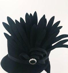 1940s black felt perching hat with felt feather flourish. Ribbon trim is also interesting.
