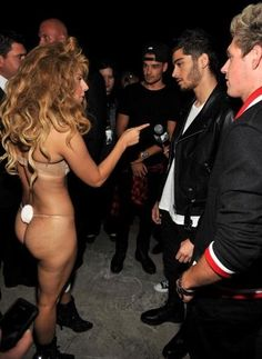 JK they're waiting for her to turn around HOLY CRAP LADY GAGY PUT SOME CLOTHES ON. -H
