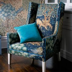 The Brook Velvet Fabric 'The Brook' design created by Morris & Co.'s designer Alison Gee, inspired by medieval tapestries, printed on velvet with a deep red background.