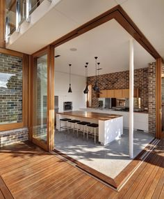 beautiful, functional aesthetic. wood complements the brick tones.