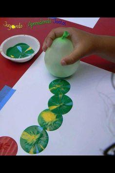 Ballon afdruk: stempelen met ballonnen en verf.