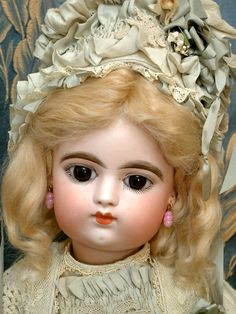 """kathylibratysdolls.com 22"""" FRANCOIS GAULTIER BEBE Antique french Doll. Bisque socket head on a fully jointed French FG body with jointed wrists. Beautiful big chocolate brown almond cut paperweight eyes."""