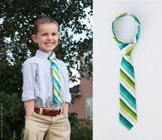 Little boy tie, from man's tie. With knot, not elastic or clip. Cut middle of length of tie, adjust width of tie at tip.