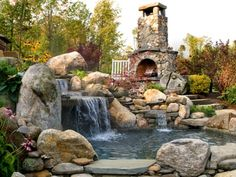 A stone fireplace and a waterfall into a pond. Love it.