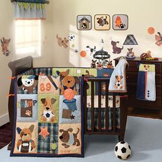 Lambs & Ivy Bow Wow 9-Piece Crib Bedding Set  @Michelle Flynn lee -  wonder if the crib sheet is your colors and sporty for Jim's liking too?