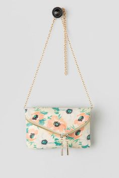 Pretty as can be, the Lucia Floral Clutch is full of clever designs! The small clutch has a soft floral print with a zipper closure on the fold over flap. Perfect spring and summer floral print clutch.