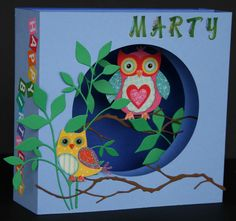 Three layer shadow box card that folds flat  using Memory Box dies  and owl stickers.