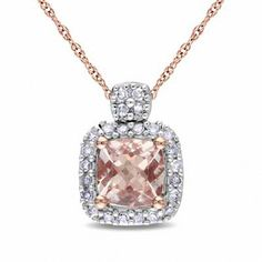 Express your love with this glistening morganite and diamond pendant. Beautifully crafted in warm 10K rose gold, this pendant showcases a 5.0mm cushion-cut pale pink morganite. A border of shimmering round diamonds wraps this center stone in a sparkling embrace, while the diamond-lined bale is a thoughtful touch. Radiant with 1/10 ct. t.w. of diamonds and finished with a bright polish, this heart suspends close to hers along a 17.0-inch rope chain that secures with a spring-ring clasp.