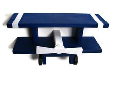 so love!!!!---Wooden Airplane Biplane Wall Shelf Decor, Navy and White Airplane, Children's Decor. $48.00, via Etsy.