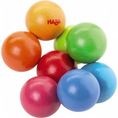 Magica is a wonderful clutching toy made of beech wood threaded over a sturdy, cloth-covered blue band. The eight rainbow colored balls on the band roll and twist in an ever changing and calming manne