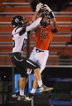 Ames defensive back Carter Mumm makes an interception as Sioux City West wide receiver Kellen Fitch tries to deflect the ball during the first quarter on Saturday at Ames High School. Photo by Nirmalendu Majumdar/Ames Tribune http://www.amestrib.com/sports/20160930/prep-football-ames-cruises-to-victory