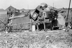 Fall of France, 1940: Two German officers and one NCO pose on a wrecked French tank command vehicle Somua S35. The Somua built to equip the Cavalry armored divisions, it was for its time a relatively agile medium-weight tank, superior in armor and armament to both its French and foreign competitors. Its well-sloped, mainly cast, armor sections made it expensive to produce and time-consuming to maintain. This example has 2 antennas,a departure from the typical design.